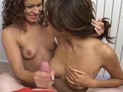 Two Amazing Brunette Babes Handle One Juicy Pole