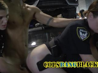 Stacked chicks in cop uniforms get banged in threesome with strong black stud