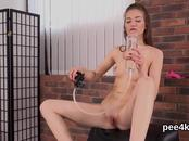 Charming chick is pissing and finger fucking hairless twat