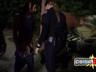 Crazy hot bitches in cop uniforms go down on each other while fucking in interracial threesome