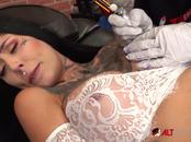 Beautiful babe Janey Doe has her big boob tattooed
