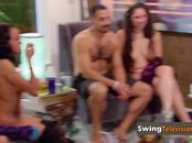 Odd couple strips down while they play with other swingers