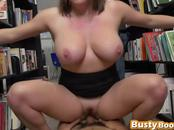 Short haired and big tits secretary riding a big cock in a library