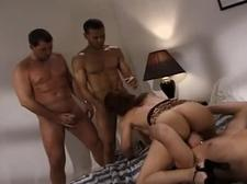 Three lucky dudes pleasure a hot babe