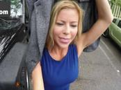 Boobed MILF sucks cock in a tow truck