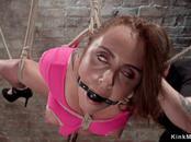 Brunette hottie in pink dress hogtie