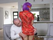 Purple haired Asian pleasing a big white dick