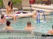 Swinger couples jump naked into the pool to play water basketball as a foreplay game.