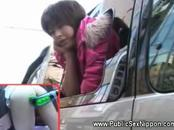 Asian girl leaning out and toyd in public