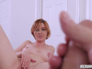 Watching my stepmom while she plays her pussy