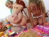 Frisky lesbos fill up their huge arses with cream and squirt it out