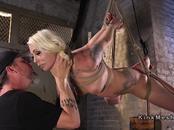 Tattooed busty blonde vibed in bondage