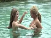 Two busty lesbians play