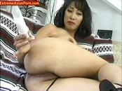 Busty asian chick plays with her pussy