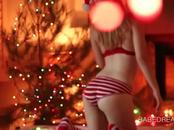 Dream  blonde  teasing her assets by the Xmas tree