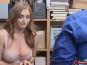 Busty redhead sucks officers cock after getting caught stealing