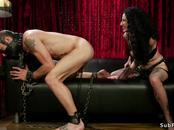 Busty dominatrix rides strapped male slave