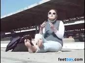 Chick Smokes With Her Feet Out