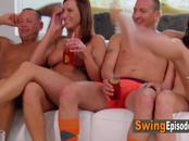 Swinger amateur couples play ''I never had'' game. They all get naked and horny slowly.