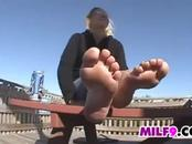 Mature Woman Teases Feet Outside