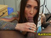 Beautiful woman with blue eyes delights while taking directors BBC