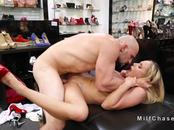 Milf gives footjob in shoes shop