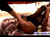 Black girlfriend enjoys stripping in bedroom