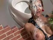 Classy glory hole babe masturbates while sucking on cock