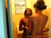 Fun-loving vixens from Africa finger and lick their pussies in bathroom
