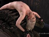 Blonde in back bend device hard flogged