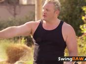 Kristen and Joe are welcomed by swinger house hostess