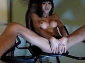 Naughty shemale masturbates her stiff unit in chair