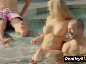 Topless swinger girls are taking the sun while receiving oral sex.