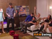 Laura engages in hot foreplay with other kinky swinger wives in the red room