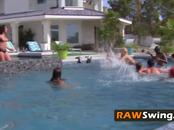 Stunning swinger girls are horny and sunbathing next to the pool side.