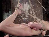 Brunette gagged and backbend bondage